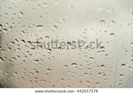 Water drops on a window glass after the rain. - stock photo