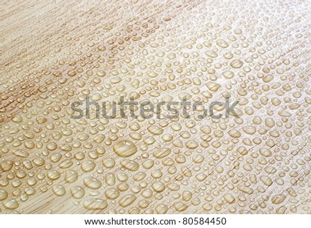 Water drops on a wooden surface. - stock photo