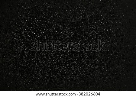 water drops on black background.  - stock photo
