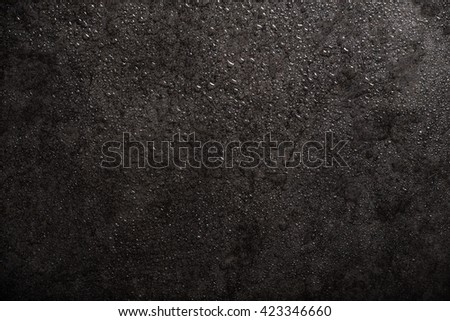 water drops on black marble  - stock photo