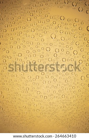 water drops on brown background. - stock photo