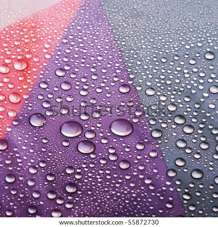Water drops on colored flat surface - stock photo