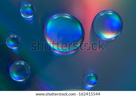 water drops on colorful background - stock photo