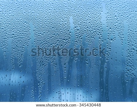 Water drops on glass naural bright background - stock photo