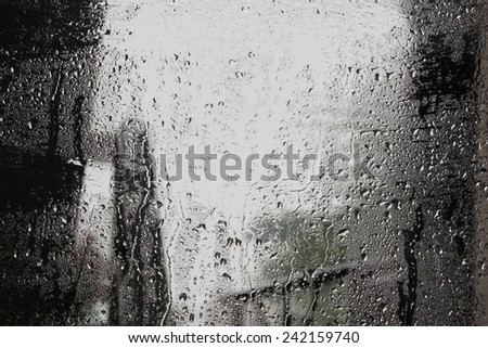 Water drops on glass wallpaper - stock photo