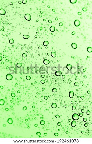water drops on green glass