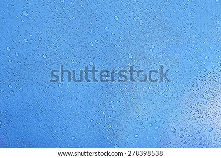 Water drops on light blue background