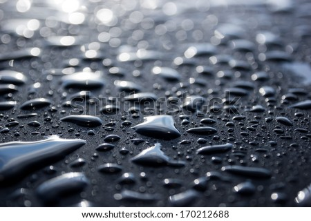 Water drops on metal surface. Abstract background - stock photo