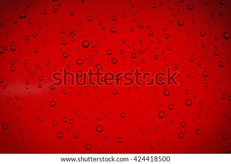 Water drops on red background - stock photo