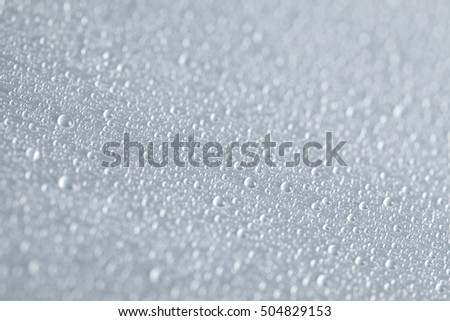 Water drops on steel background