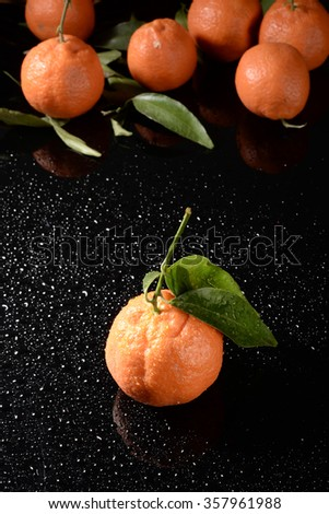 water drops on tangerines - stock photo
