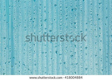 Water drops on the background. Condensate. Mint color background. Water drops background. - stock photo