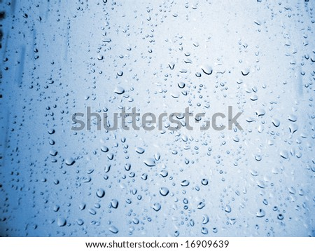 Water drops on the blue glass