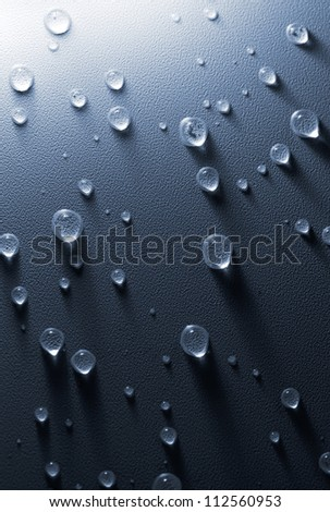 Water drops on the embossed surface of tension ceiling