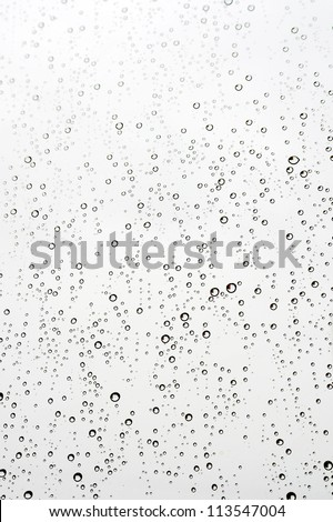 Water drops on the window. Abstract background. Shallow DOF. - stock photo