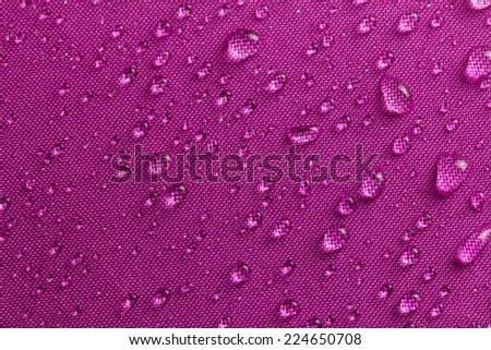 Water drops on umbrella - stock photo