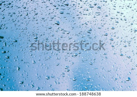 Water drops on window glass, blurred on the edges - stock photo