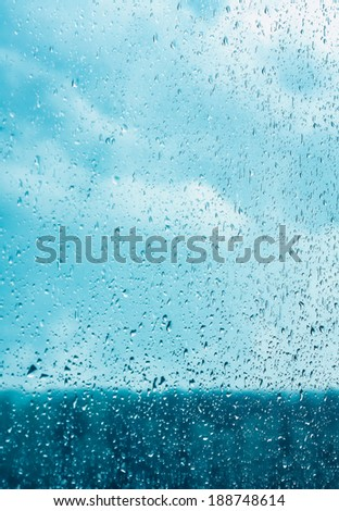 Water drops on window glass, blurred on the edges. Image processing with color filter effects - stock photo