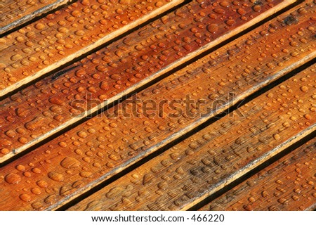 Water Drops on Wood Deck - stock photo