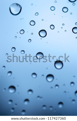 Water drops over blue background