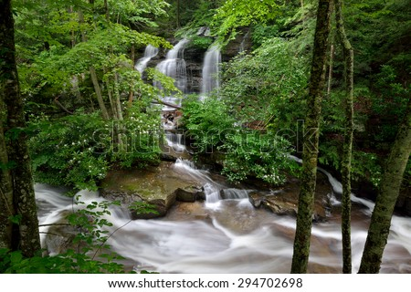 Water enters Laurel Creek over a small waterfall after a rain just outside Beckley, West Virginia - stock photo