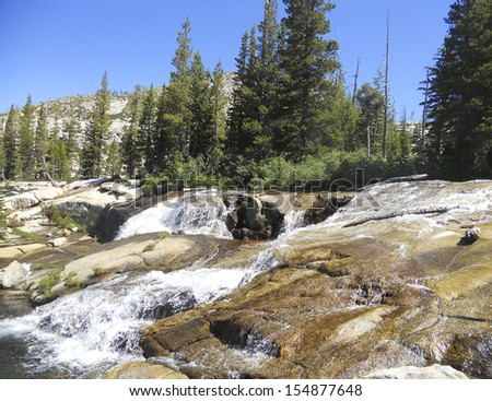 water fall and trees - stock photo
