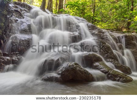 Water fall deep in the jungle  - stock photo