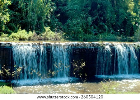 water fall from the weir dike dam in dry paint - stock photo