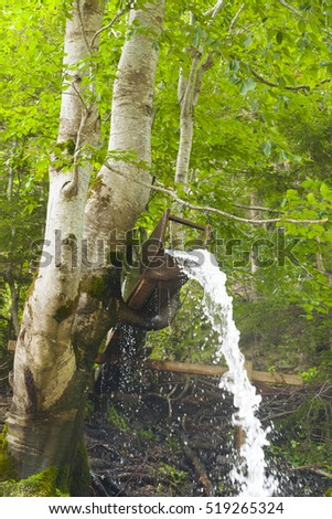 water fall from wooden pipe