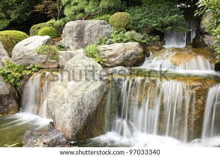 Water fall in Japanese garden - stock photo