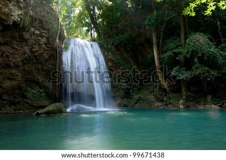 Water fall in spring season located in deep rain forest jungle