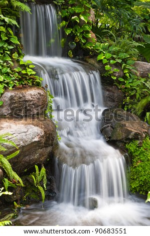 Water fall in the garden - stock photo