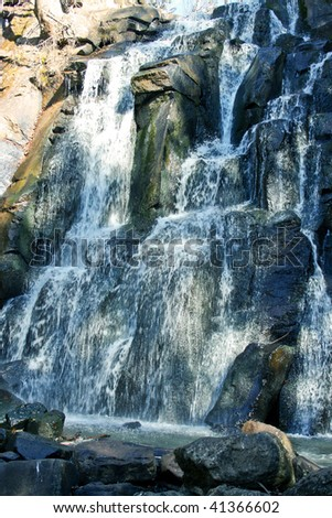 Water falls from high mountain - stock photo
