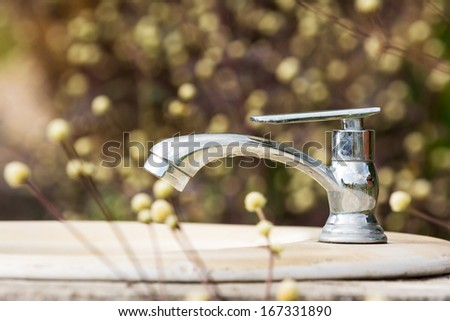 Water faucet on nature - stock photo