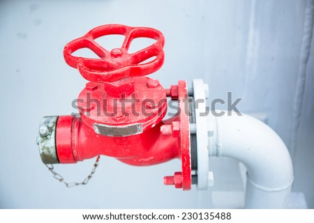 Water Fire Hydrant Red color on white water pipe - stock photo