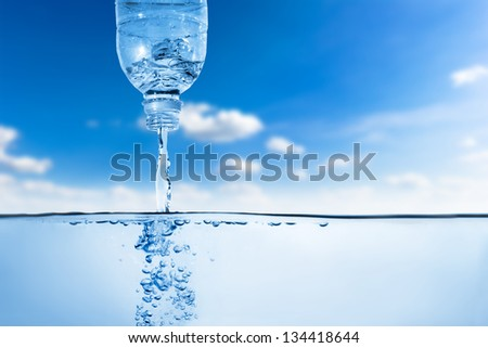 Water flow from bottle and forming bubble. Fresh healthy background - stock photo