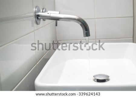 Water flow from chromed steel faucet