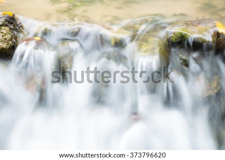 Water flowing down. Water flows into a small home garden aisle. - stock photo