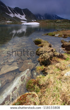 Water flowing from glacier lake,Retezat mountains, Romania - stock photo