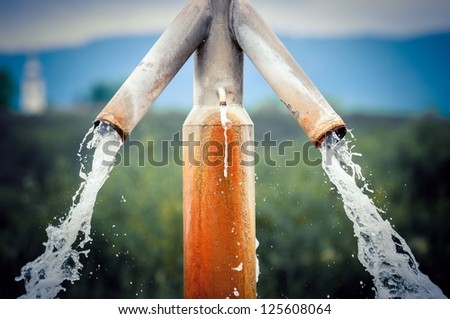 Water flowing from outdoor tap and getting wasted - stock photo