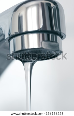 Water flowing from water faucet, close up - stock photo