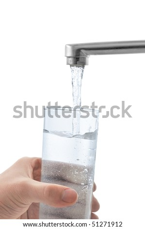 Water flows into the glass. Isolated on white. - stock photo