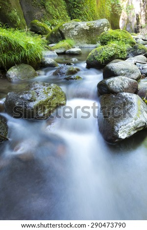 Water flows of the river - stock photo