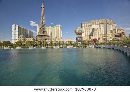 Water fountain at Bellagio Casino with Paris Casino and Eiffel Tower in Las Vegas, Nevada - stock photo