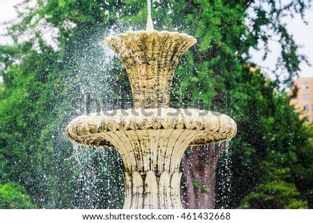 Water fountain in park. Splashing streams of in stream pouring from . on surface lake. in summer .