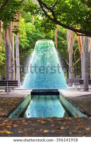 Water fountain with water jets flowing from top - stock photo
