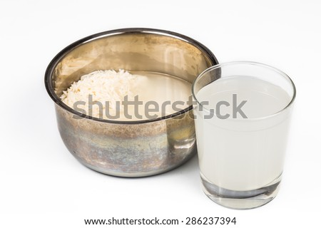 Water from rice rinse can be used as natural plant fertilizer - stock photo