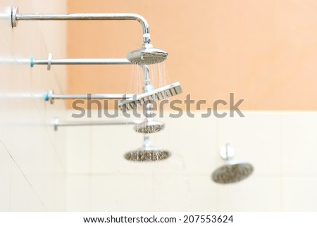 Water from the shower at swimming pool - stock photo
