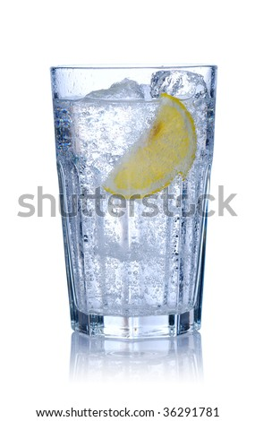 Water glass with ice & lemon isolated on white. Soft reflection.