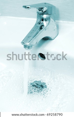 Water going down the drain - stock photo